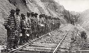convict labor  - a work gang - black prisoners in prison stripes working on railroad tracks -- click on the image for a larger view and more information