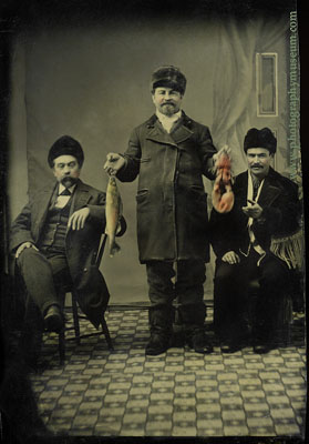 tintype of three men with fish and lobster - included in the book Daguerre's American Legacy